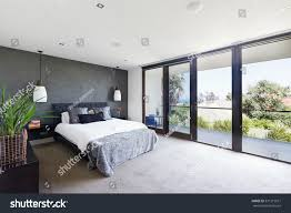 spacious interior designer master bedroom luxury stock photo