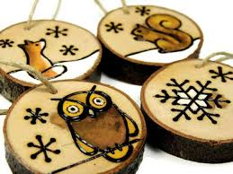 i wood burned these woodland animal ornaments by on slices of