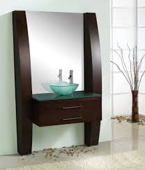modern brown stained wooden bathroom vanity with green glass