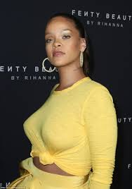 topless pictures of rihanna rihanna glows in yellow skirt for fenty beauty nyfw launch daily