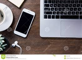 coffee cup smartphone with earphones laptop and succulent plant
