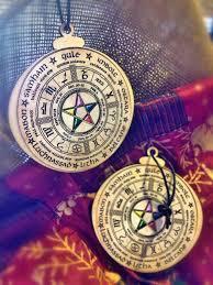 set of two yule ornaments wheel of the year por bellbookandcharm