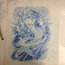 blue ink mermaid in crashing water looking in the mirror tattoo