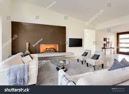 beautiful living room luxury home fireplace stock photo 297981515