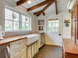 country kitchen with white cabinets country kitchen with exposed beam by mary hayes zillow digs zillow