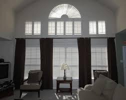 decorating bay window area comfy beige davenport sofa lamp tube