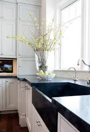 white sink black countertop white kitchen cabinets with black apron sink transitional kitchen