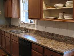 granite countertop black kitchen cabinets with white appliances
