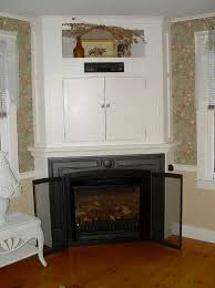 corner fireplace mantels with tv above home design ideas