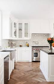 sink faucet kitchen backsplash white cabinets herringbone tile