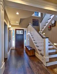 dark wood floors and white baseboards window trim boys rooms