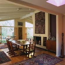 inspiration for a midcentury modern dining room remodel in baltimore with a brick fireplace and a