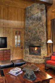 buffet table with fireplace holiday decor wood wall paneling with stone fireplace and modern