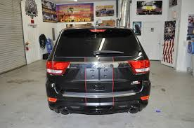 racing jeep cherokee racing skins jeep grand cherokee u2013 matte black racing stripes
