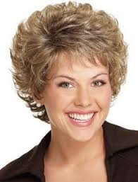 permed hairstyles women over 60 short curly haircut for women over 50 lively curls in razored cut