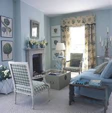 blue country style living rooms with trunfk and blue sofa