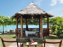 round table discovery bay whispering waters on the beach jamaica villa by linda smith