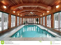 swimming pool with wood ceiling beams royalty free stock