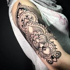 style upper arm tattoo on the right upper arm