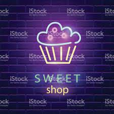 sweet shop neon sign on dark brick wall background stock vector