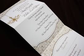 folding wedding invitations gold brown chandelier and ornate pattern vertical trifold