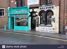 two small shops in middlesbrough offering piercing and barber