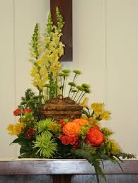 funeral home decor how to incorporate flowers with funeral urns fsn funeral homes