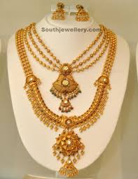 gold jewellery by khazana jewellery designs