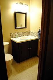 Backsplash Bathroom Ideas by Thin Strip Of Glass Tile As A Bathroom Vanity Backsplash For