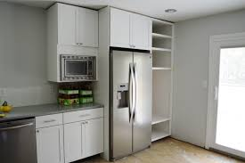 Microwave In Kitchen Cabinet by Customizing And Hanging The Microwave Cabinet Loving Here