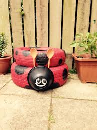 our ladybird planter made with tyres a plastic bowl and wooden