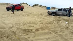 yellow jeep on beach ford raptor pulls out dodge durango at the dunes pismo beach