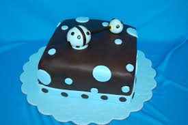 customised cakes by jen blue and brown baby shower rattle cake