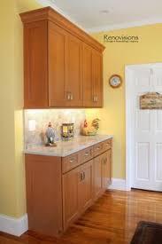 Brushed Nickel Backsplash by A Recent Kitchen Renovation By Renovisions Wood Cabinetry Quartz