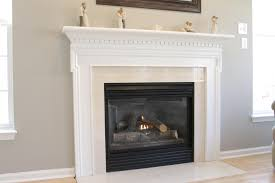 White Grey Laminate Flooring White Fireplace Mantel With Black Woden Top Connected By Grey Wall
