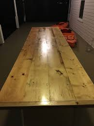 using marine waterlox to refinish our outdoor dining table old