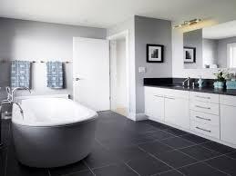 white bathrooms with dark floors this lengthy white bathroom