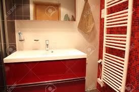 modern finnish bathroom with sauna red tiles and heater stock