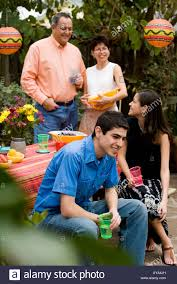 mexican american family at a picnic table the backyard stock photo