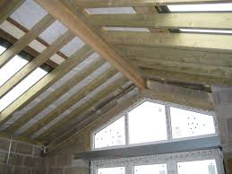 exterior exciting sloped ceiling with ceiling beams and garage