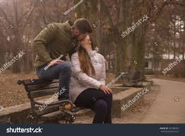 young couple sitting park bench stock photo 540188269