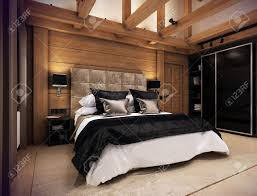 the cozy bedroom is in the attic of a chalet huge bed with