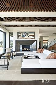 best 25 modern ceiling design ideas on pinterest modern ceiling modern living room with slatted wood ceiling wood ceilingsinterior design