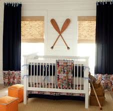 crib baby beside striped paint wall lighting idea in ceiling baby