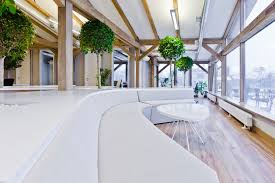 cool green office design with tree by openad home design and