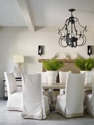 slip covered dining room farmhouse with white upholstered side chairs