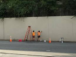 work starts on 400 foot long bethesda mural bethesda beat jessie unterhalter and katey truhn start painting a mural on a 400 foot long concrete wall along arlington road via bethesda urban partnership