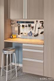 columbus garage storage cabinetry design and wall organization garage storage workbench with a butcher block countertop and hanging cabinets in westerville ohio innovate