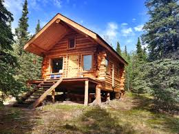 our cabin in alaska sits at the base of a ridge overlooking a vast