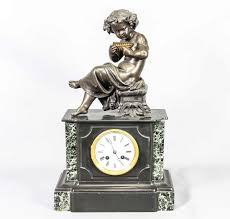 fireplace clock in the black marmor grooved base left and